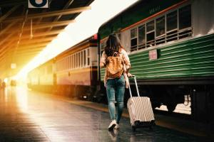 Woman traveler walking by train