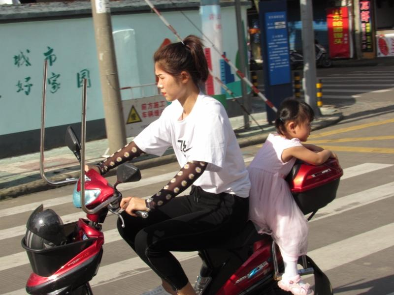 Chinese kid and mom on ebike