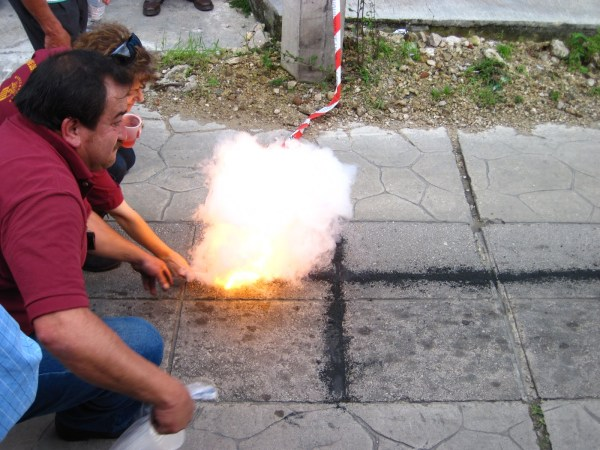 lighting the black powder with a cigarette