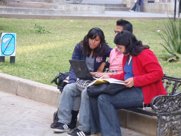Young Mexicans in a park in simple clothes