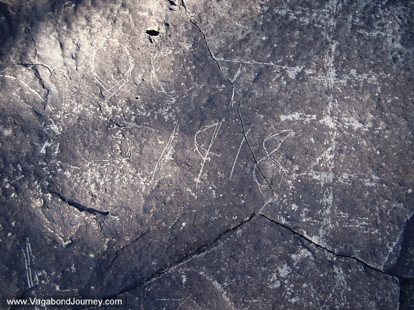 Prehistoric and historic petroglyphs side by side