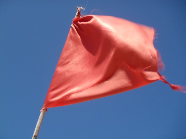 Red flag on beach means dangerous swimming
