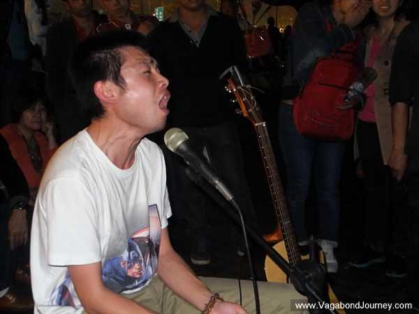 Ryan Lee singing passionately
