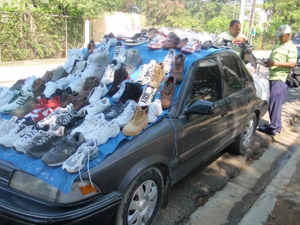 Street side shoe salesman