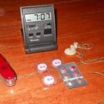 Alarm clock, swiss army knife, pills