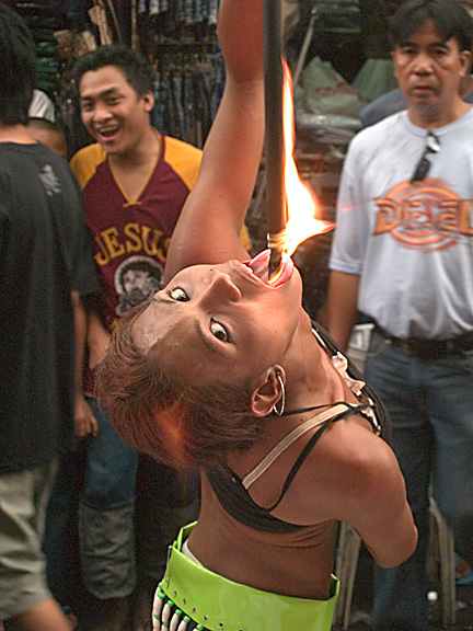 Fire eater at the Black Nazarene Festival in Manila
