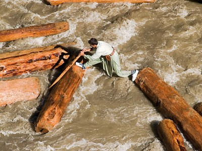Sending logs down the river for timber is a dangerous trade, several men die each year along the Chitral River