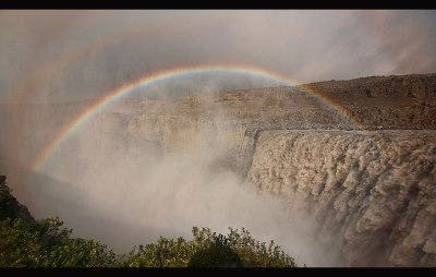 Rainbow over the amazing Dettifoss waterfall in Vatnajökull Nat