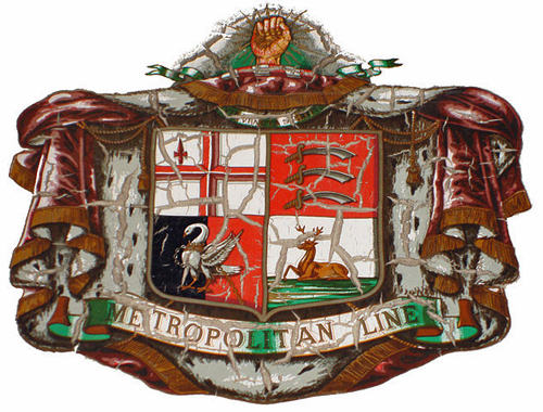 Crest of the Metropolitan Underground Railway By Oxyman (Own work) [GFDL (http://www.gnu.org/copyleft/fdl.html), CC-BY-SA-3.0 (http://creativecommons.org/licenses/by-sa/3.0/) or CC-BY-2.5 (http://creativecommons.org/licenses/by/2.5)], via Wikimedia Commons