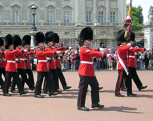 The British Army in a traditional role guarding Buckingham Palace and the Queen