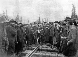 Donald Alexander Smith driving the last spike of the Canadian Pacific Railway By Ross, Alexander, Best & Co., Winnipeg [Public domain or Public domain], via Wikimedia Commons