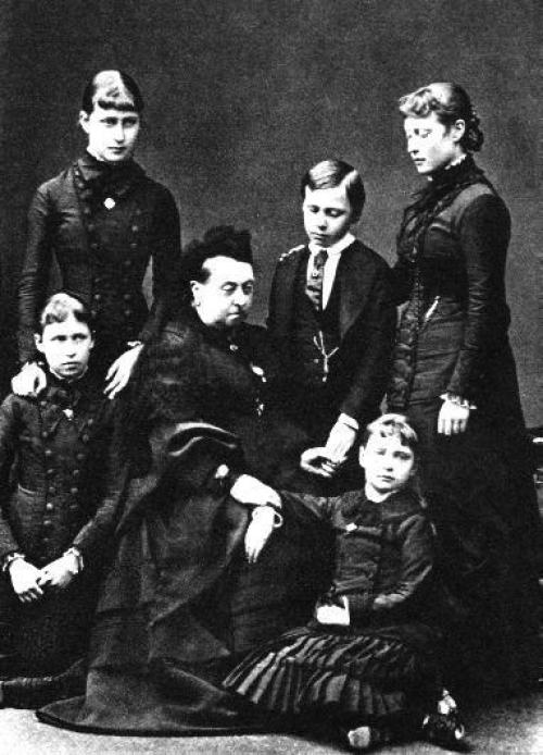 Princess Irene, kneeling on the left, with her grandmother Queen Victoria and, from left to right, her sister Elizabeth, brother Ernst-Ludwig, sister Victoria and, seated on the floor, her sister Alix in February 1879, two months after the death of her mother.