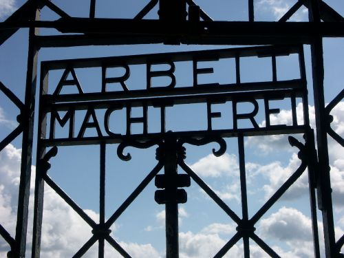 "Detail of the main gate at Dachau concentration camp in Germany, displaying the famous ""Arbeit Macht Frei"" slogan By Dorsm365 (Photographed by Dorsm365) [Public domain], via Wikimedia Commons"