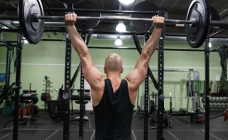 behind the neck pressing