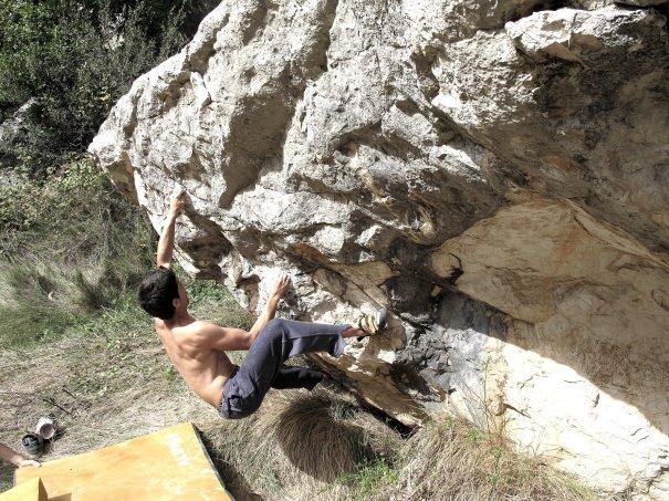Nacho climbing a boulder in Buñol.