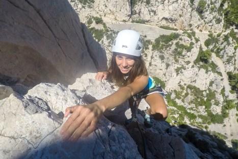 Jess climbing Arrêt de Vallon (IV+, 120m).