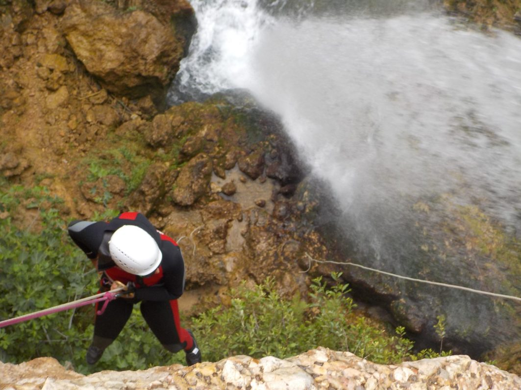 Abseiling next to the waterfall.