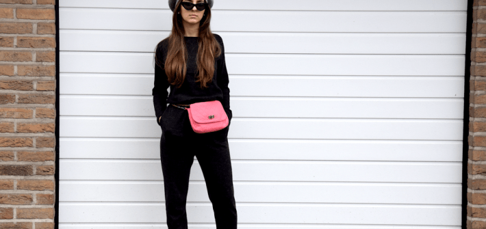 Jumsuits, cat-eyed glasses and belt bags