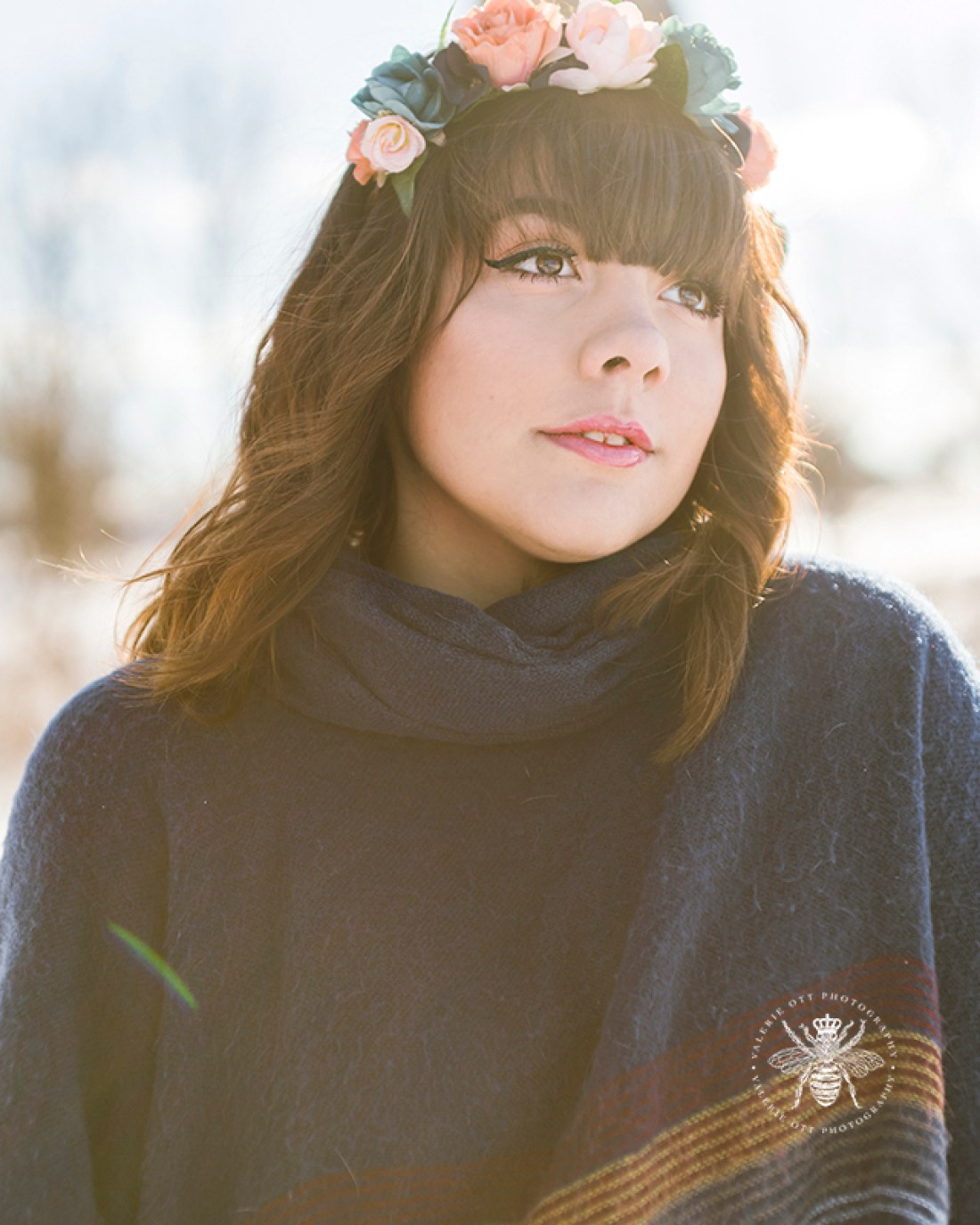 senior girl poses in flower crown and sweater
