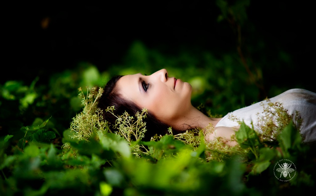 Album cover for Irish singer. She poses laid out on the grass with plants surrounding her head.