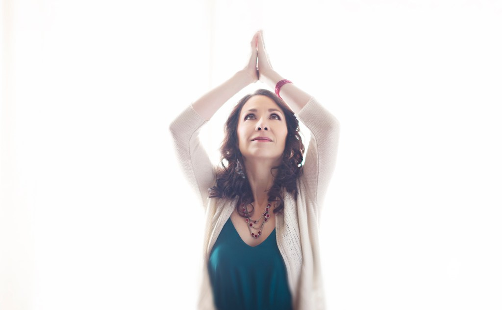 Album cover for Irish worship singer. She poses with her hands in prayer above her.