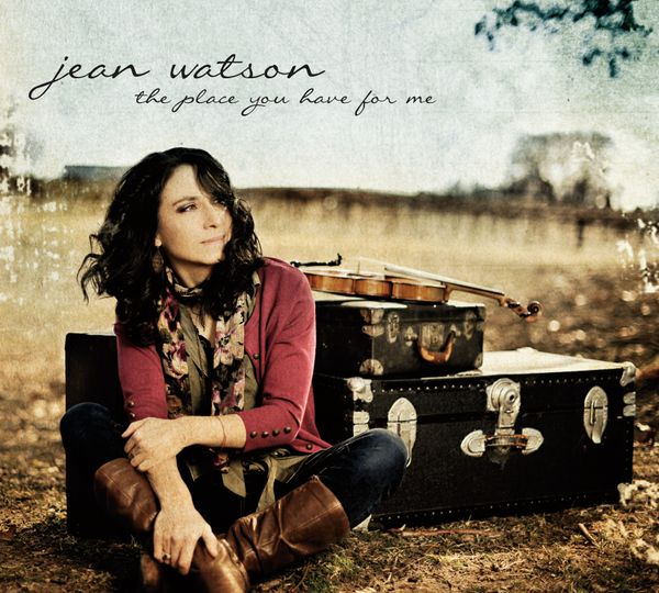 Album cover for Irish singer. She poses sitting in a field with her violin. Text reads: Jean Watson, the place you have for me