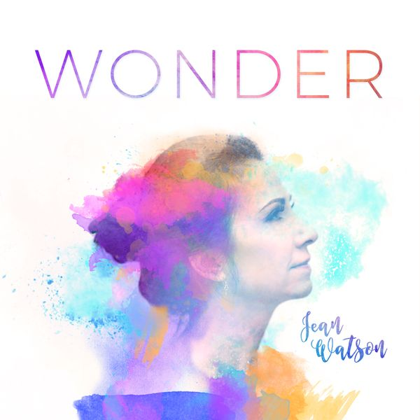 Album cover for Irish singer. Graphic design of side profile covered in rainbow splatters of paint. Text reads: Wonder, Jean Watson