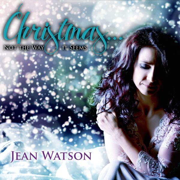 Christmas album cover for Irish singer. She poses wearing lace with snow around her. Text reads: Christmas... not the way it seems, jean watson
