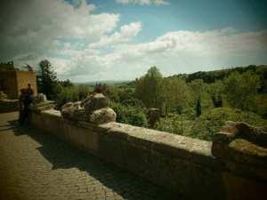 Etruscan tombs adorning parapet in Medieval Tusc