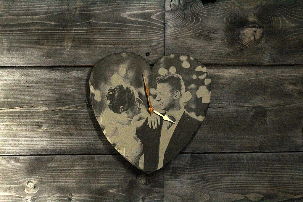 The beautiful wedding couple captured forever in Welsh slate with this unique heart clock gift.