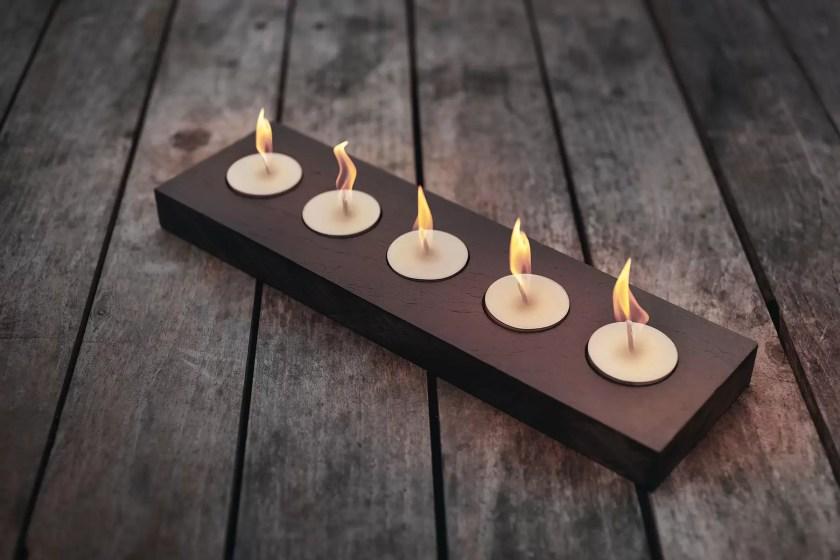 welsh slate 5 light tealight holder with lit candles