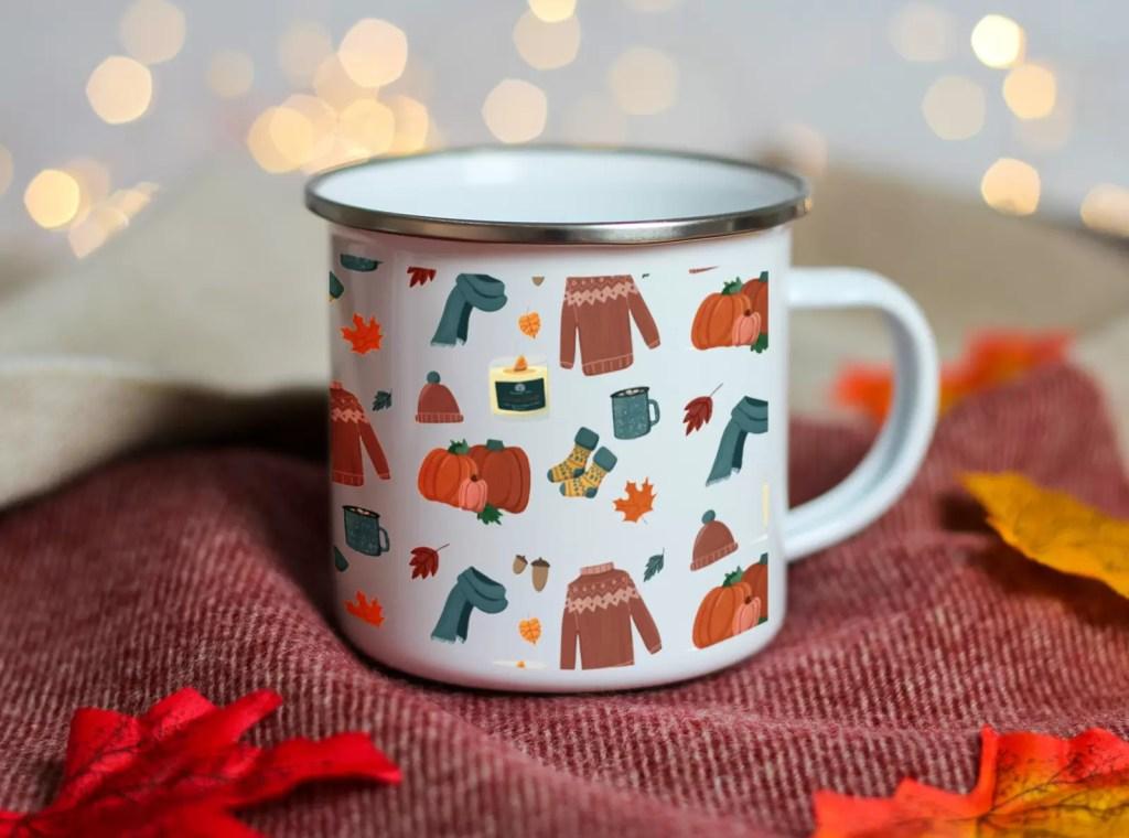 White enamel camping mug with autumn inpsired designs