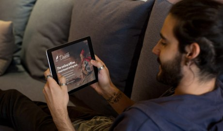 Man looking at Dabble website on his ipad