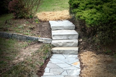 Flagstone pathway with grey crab orchard stone and dry laid with stone slab steps