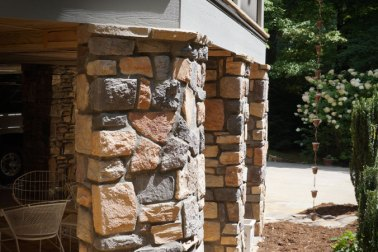 Manufactured Stone columns with exposed mortar joints