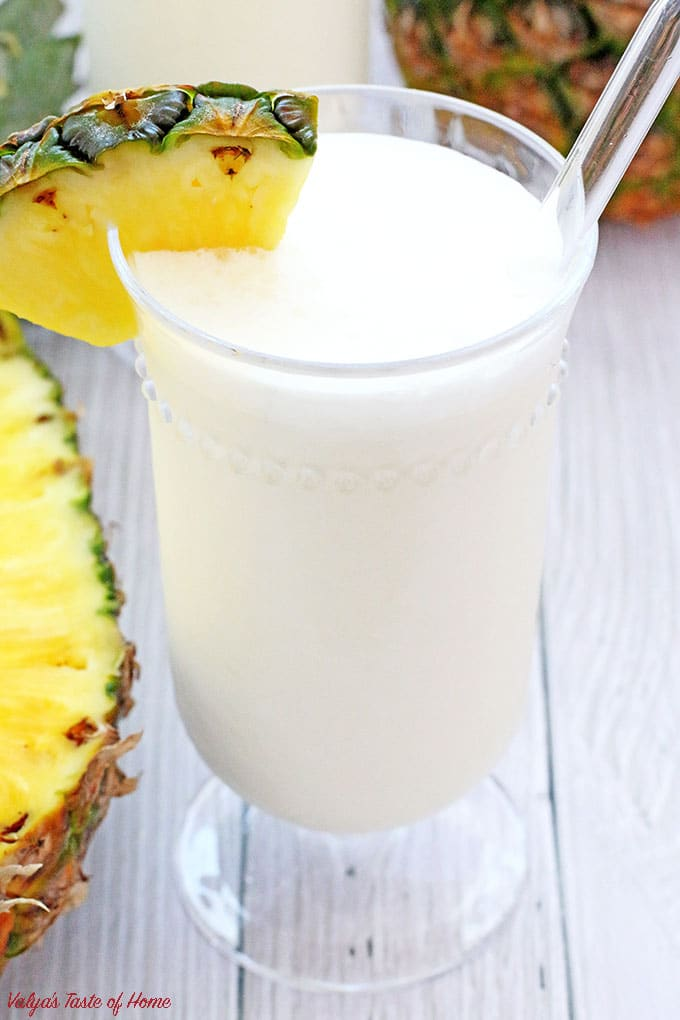 Pina Colada Smoothie is one of the most popular tropical drinks for a very good reason: the perfect creamy mix blended out of pineapple juice. There are many types of Pina Colada recipes, but I make mine simple. If you like the coconut flavor in yours, you may add coconut cream or milk instead of half & half. Just throw all the ingredients into the blender and the rest is done for you. It melts quickly so make sure to serve it right away. | www.valyastasteofhome.com