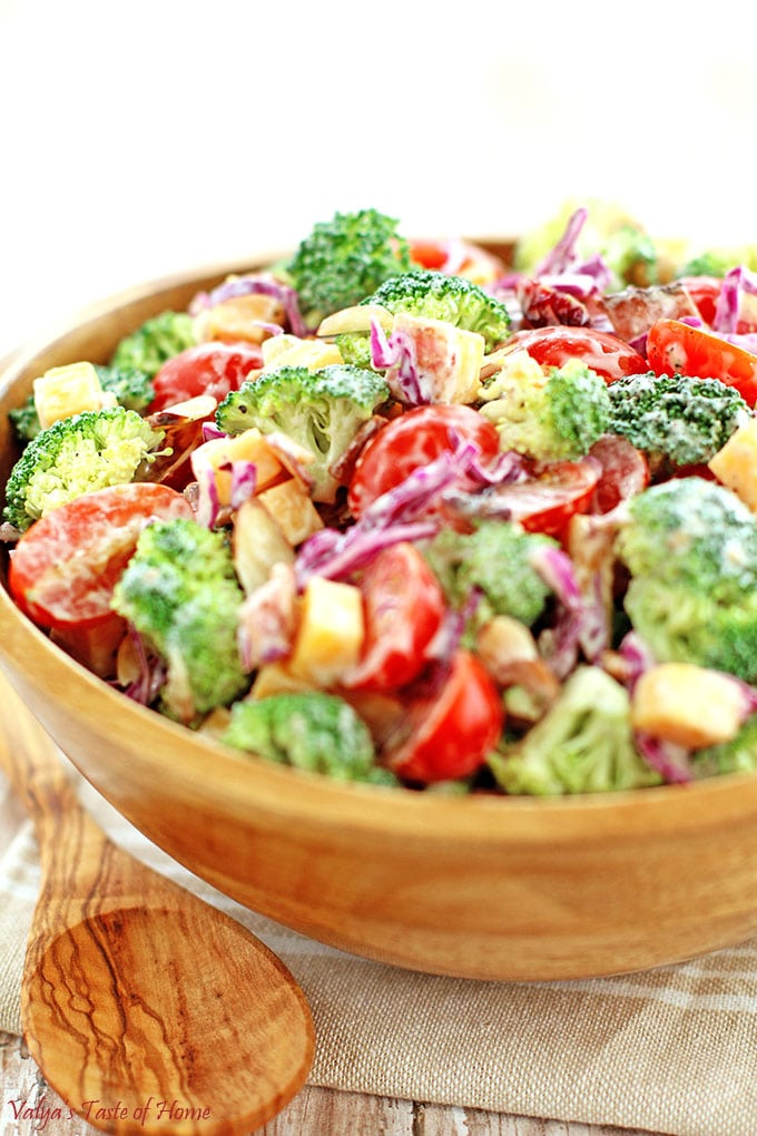 This Creamy Cheddar Broccoli and Tomato Salad Recipe is a great addition to your holiday feast or any occasion at any time of the year. Surprise and delight your family or guests with this different but totally delicious and beautiful looking salad on your table. Its taste is so flavorful, crisp, refreshing and satisfying, it is sure to impress! #creamybroccoliandtomatosalad #holidaysalad #creamycheddarbroccolitomatosalad #valyastasteofhome