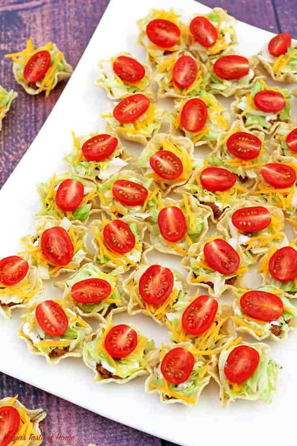 beautiful appetizers, cheddar cheese, Cinco de Mayo, decor appetizer, delicious appetizers, holiday food, kids aproved, kids love it, lettuce, mini cherry tomatoes, mini tacos, Taco Bites Appetizers