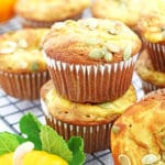 These Pumpkin Cheesecake Muffins are a must-bake fall treat! They are super moist, pillowy soft, fluffy, swirled with cheesecake batter, topped with pumpkin seeds and a burst of the fall flavor. #pumpkincheesecakemuffins #homemade #softandmoist #cheesecakemuffins #valyastasteofhome