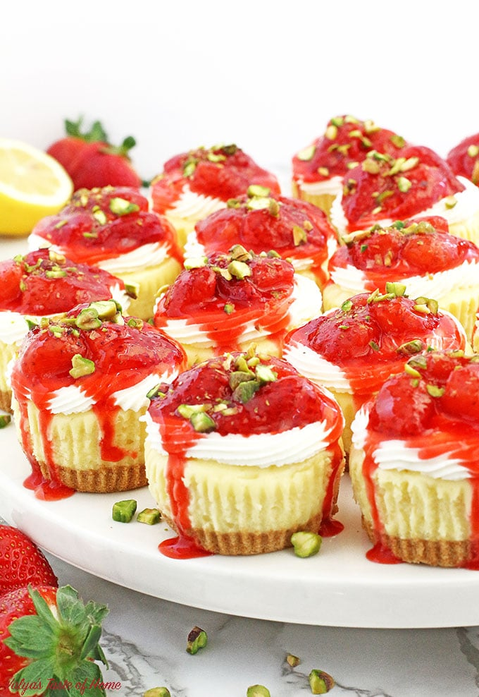 These Strawberry and Cream Mini Cheesecakes not only delicious, but just too cute to eat! They consist of creamy cheesecake filling, topped with tasty soft cream and chunky homemade strawberry sauce. Sprinkled pistachios not only finishes the beauty of these mini cheesecakes but gives delicious nutty flavor too.