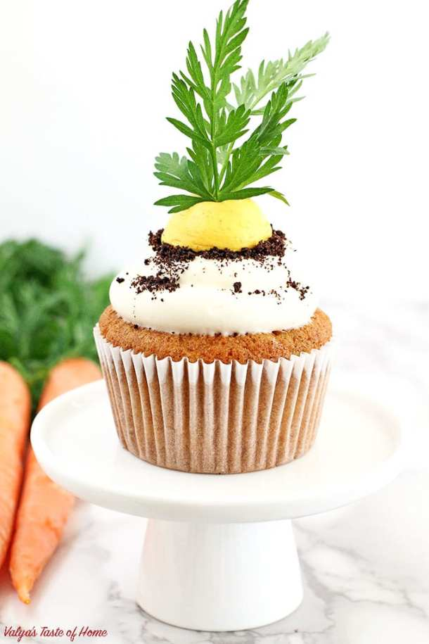 These Carrot Cupcakes with Greek Yogurt Cream Cheese Frosting are amazingly soft, light, moist, and packed with organic freshly grated carrots. Each cupcake is beautifully decorated to represent the growing carrot in the dirt.  The cream is very tasty and not sweet at all. The addition of Greek yogurt makes it taste soft and creamy, you will be licking your fingers off with every bite!
