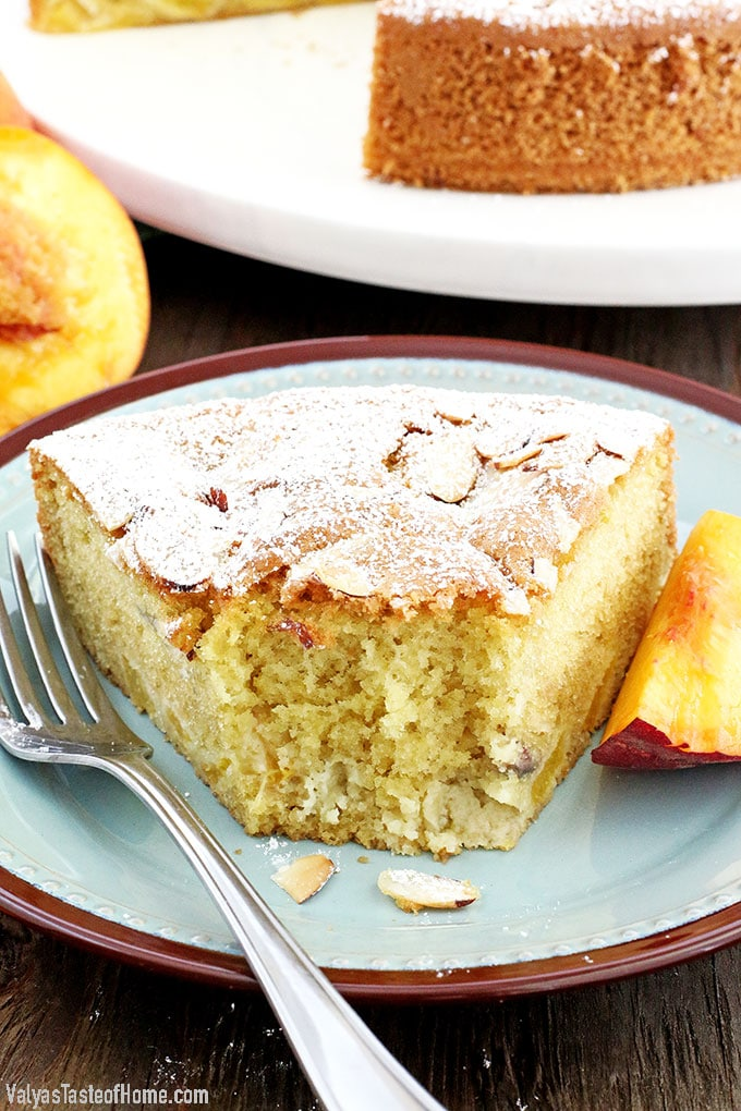 Who can resist a slice of this absolutely scrumptious Almond Peach Coffee Cake? It's light, fluffy, airy, moist, and loaded with peaches. The aroma of almond extract is phenomenal! Then topped and toasted almond slivers, making this cake not only beautiful but gives it a boost in taste as well. Every bite just melts in your mouth.