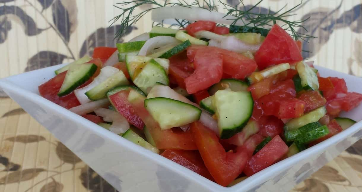 This classic Ukrainian Cucumber, Tomato, and Onion Salad Recipe continue to make our most frequent and favorite list. To really see why you simply must taste it! This refreshing goodness is created from fresh homegrown most beloved produce; cucumber, tomato, and onion. We have it most frequently during the summertime not only because these particular veggies grow in abundance but incredibly quick and so simple to produce.