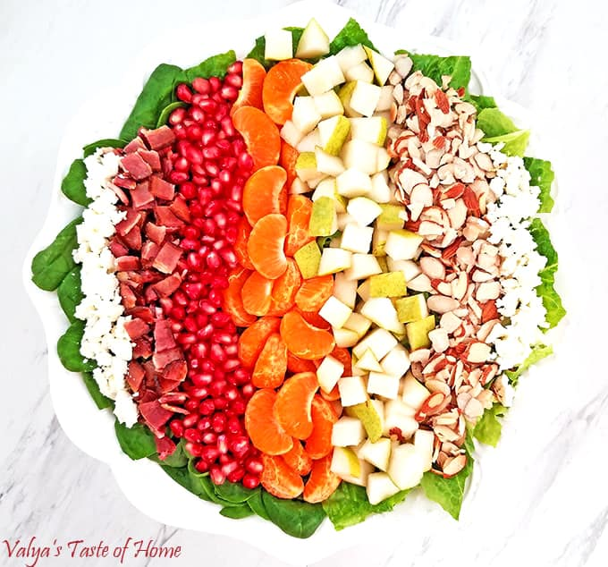 This bright and colorful Pear, Pomegranate, Mandarin Winter Salad with Homemade Ranch Dressing and some of the winter harvested fruit is so scrumptious! #wintersaladrecipe #homemaderanch #valyastasteofhome
