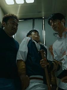 Gong Yoo, Ma Dong-Seok and Choi Woo-shik as Seok-Woo, Sang-Hwa and Young-Gook in Train to Busan.