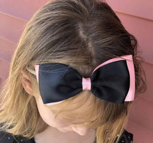 black and pink bow