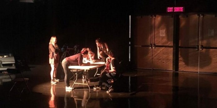 The cast of Plan Z Theatre's Still the Kettle Sings preparing for opening night