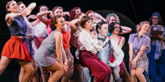 Paige Fraser, Janet Gigliotti, and Blake Sartin with the cast of the Theatre Under The Stars production of 42nd Street. Photo by Lindsay Elliott.