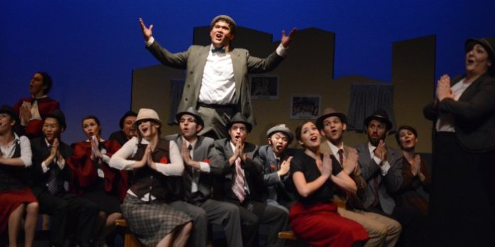 """Argel Monte De Ramos leads the showstopper """"Sit Down, You're Rockin' the Boat"""" in the Fighting Chance Productions presentation of Guys and Dolls. Photo by Jenn Suratos."""