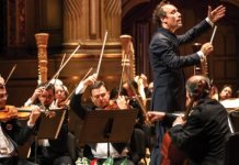 Maestro Otto Tausk conducts members of the Vancouver Symphony Orchestra.